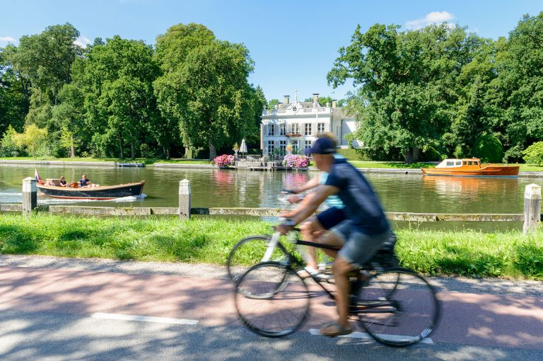 River Vecht with bicycles, motor boat and country estate