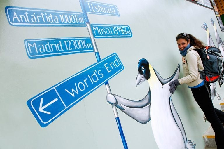 A wall painting with penguins and tourist in Ushuaia shows the distance to Antarctica