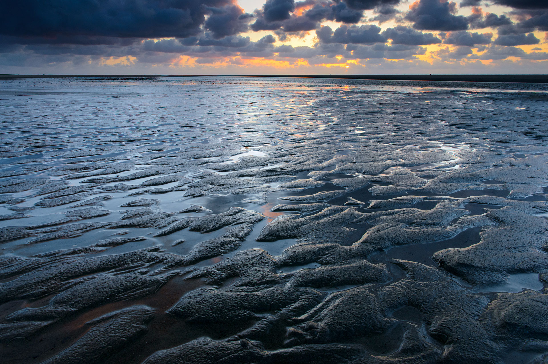 Kwade Hoek beach at low tide at sunset, with patterns.