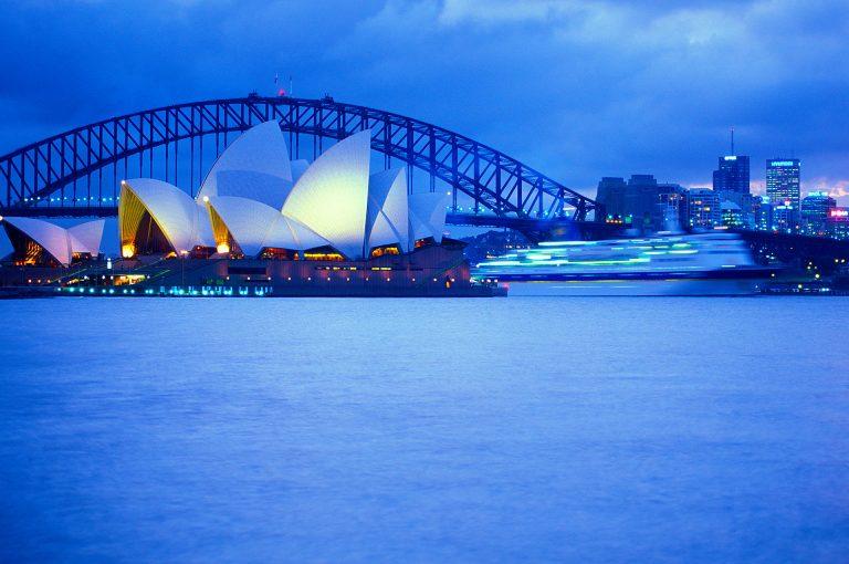 Sydney Opera Building, Harbour Bridge and passing cruise ship